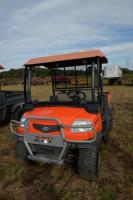 2005 KUBOTA RTV900 UTILITY VEHICLE - 2,500 HOURS - ORANGE - DIESEL - 4x4 CLUB CAR - DUMP BED  - TRAILER HITCH - REAR TIRES WORN SLICK AND  FRONT TIRES ARE WORN - RUST SPOTS ON BED -  DENTS -  SEAT TORN & SPLIT, REPAIRED WITH  GREY & BLACK TAPE - KILL SWIT