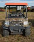 KUBOTA RTV900 CLUB CAR UTILITY VEHICLE - DIESEL 2500 - 2,499 HRS. - CAMO COLOR FRONT, GREY  BED - ORANGE TOP - BUMPER - TRAILER HITCH -  MACHINE IS CLEAN - REAR TIRES ARE WORN - SEAT  BACK COVER IS TORN - KILL SWITCH SHUTS OFF  BY WIRE ON PASSENGER SIDE -