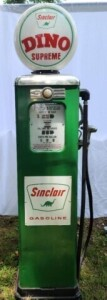 """SINCLAIR"" GAS PUMP -ERIE METER SYSTEM WITH DINO SUPREME TOP, MODERN PORCELAIN FACE, (SHOWS SOME WEAR), ROLLER HAS MISSING NUMBERS, ONE SIDE GLASS, OTHER SIDE PLEXIGLASS.  PUMP IS MISSING, REPAINTED, SOME DENTS, CRANK HANDLE MISSING.  MODERN GOODYEAR RUBB"