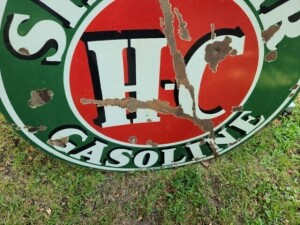 "VINTAGE""SINCLAIR H-C GASOLINE"" ROUND, OUTDOOR SIGN DOUBLE-SIDED, PORCELAIN ON METAL, FRONT SIDE HAS SOME DETERIORATION, RUSTED, CHIPPED AND SPOTS - PAINTED -  REAR SIDE HAS LARGE RUSTY SPOTS WHERE PORCELAIN MISSING, COLOR IS GOOD, SIZE 41.5"" DIAMETER"