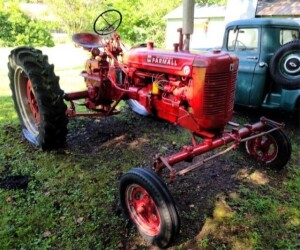 1948 MCCORMICK FARMALL SUPER C, WIDE FRONT END REPAINTED, PTO, HYDRAULIC SNAP CUPPLE HITCH WITH DRAWBAR, GOOD REAR TIRES TREAD, HAS BEEN SITTING, TRACTOR MOTOR WILL TURN OVER WITH BOOST, STARTER BUTTON NOT WORKING PROPERLY AT THIS TIME, GAS SUPPLY IS FROM