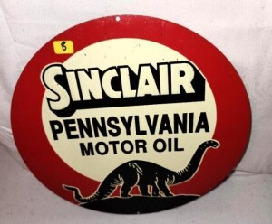 "VINTAGE ""SINCLAIR PENNSYLVANIA MOTOR OIL"" ROUND TIN SIGN WITH DINOSAUR - BRIGHT COLORS, SHOWS FEW SCRATCHES AND WEAR - SOME DETERIORATION AT BOTTOM WITH RUST - SIZE 10.75"" DIAMETER"