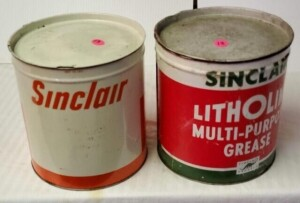(2) - SINCLAIR LITHOLINE MULTI-PURPOSE GREASE CANS TOP HAS BEEN REPAINTED.  MULTIPLE SCRATCHES, SHOWS SOME RUST AROUND TOP, BOTTOM  RUSTY -- SINCLAIR GREASE CAN, LETTERING COLOR  BRIGHT, NUMEROUS DENTS IN TOP, SOME SCRATCHES, BOTTOM SHOWS LIGHT RUST.