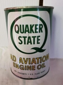 QUAKER STATE AD AVIATION ENGINE OIL QUART CAN FULL COLOR GOOD, WRITING BRIGHT,  SOME DENTS, TOP SHOWS LIGHT RUST AROUND EDGE, RIM BENT, DENTS NEAR BOTTOM
