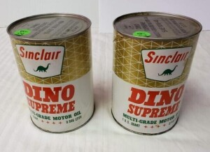(2) SINCLAIR DINO SUPREME MOTOR OIL QUART CANS FULL CANS - 1ST CAN WRITING IS CLEAR, FEW SMALL SPOTS, WRITING IS CLEAR ON TOP WITH FEW SMALL SPOTS, BOTTOM RIM SHOWS SLIGHT DISCOLORATION, BOTTOM LIGHT PITTING -- 2ND CAN HAS SMALL RUB ON EMBLEMS, WRITING LE