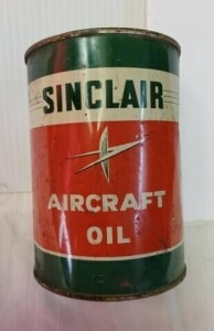 SINCLAIR AIRCRAFT OIL FULL QUART CAN, SHOWS WEAR, WRITING IS LEGIBLE, CAN IS FADED, SCRATCHES, NUMEROUS DENTS, TOP RIM AND TOP IS RUSTY AND PITTED, BOTTOM AND BOTTOM RIM SHOWS RUST PITTING