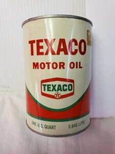TEXACO MOTOR OIL FULL QUART CAN BRIGHT WRITING, GLUE RESIDUE FROM STICKER, FEW LIGHT DENTS, EMBLEM IS BRIGHT, TOP AND TOP RIM BRIGHT, SMALL TARNISH LOWER RIM, BOTTOM IS BRIGHT WITH SMALL SPECK