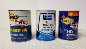 (3) EMPTY MOTOR OIL QUART CANS - (2) SUNOCO MOTOR OIL CANS, DX EMBLEM, EXTRA HEAVY DUTY, OPENED CAN WITH 2 HOLES ON TOP, COLOR IS GOOD, SHOWS SOME RUBS AND WEAR, SLIGHT DENT AROUND TOP, TOP RIM SHOWS LIGHT TARNISH, TOP SILVER IS WORN, LOWER RIM MOSTLY CLE
