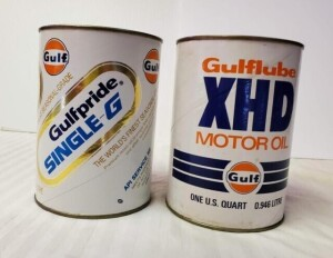 (2) GULF MOTOR OIL EMPTY QUART CANS - GULFPRIDE SINGLE-G MOTOR OIL QUART CAN, EMPTY CAN WITH NO HOLES, COLORS ARE BRIGHT, CAN IS CLEAN, RIMS ARE CLEAR, TOP AND BOTTOM CLEAR -- GULFLUBE XHD MOTOR OIL CAN, TOP IS OPENED, SHOWS SOME SPOTS AND DISCOLORATION,
