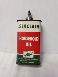 VINTAGE SINCLAIR HOUSEHOLD OIL 4 FL. OZ. CAN ALMOST EMPTY, LEAD TOP, RECTANGLE, DINO EMBLEM, NUMEROUS SCRATCHES, TOP AND TOP RIM SLIGHTLY PITTED, SPOUT CAP INTACT, BOTTOM IS CLEAN