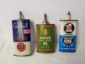 (3) VINTAGE TIN OIL CANS - GULFOIL HOUSEHOLD LUBRICANT, GULF EMBLEM, 4 FL. OZ. EMPTY CAN, LEAD TIP, NO CAP, OVAL, DEEP COLOR, SLIGHT DENT ON FRONT, SCRATCHES ON BACK WITH SLIGHT DENT -- SINGER SEWING MACHINE OIL, 3 FL. OZ EMPTY CAN, LEAD TIP, NO CAP, SHOW