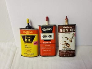 "(3) VINTAGE GUN OIL CANS, MOSTLY FULL OUTERS 445 GUN OIL, 3 OZ, SIZE 3.75"" TALL, PLASTIC SPOUT AND CAP, COLOR IS GOOD, TOP SHOWS SOME WEAR, RUBS, SILVER BOTTOM CLEAN -- REVELATION GUN OIL, 3 FL. OZ. CAN, SIZE 4.5"" TALL, PLASTIC SPOUT AND CAP, STICKER RESI"