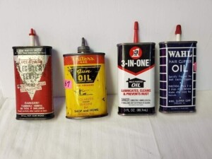 "(4) VINTAGE OIL CANS - 3-IN-ONE MULTI-PURPOSE IS MOSTLY FULL, 3 FL. OZ., SIZE 4"" TALL, PLASTIC SPOUT AND CAP, GOOD COLOR, VERY SMALL USE WEAR, BOTTOM CLEAN - OTHER CANS APPEAR EMPTY -- OUTERS 445 GUN OIL, 3 OZ. CAN, SIZE 3.5"" TALL, LEAD SPOUT, NUMEROUS SC"
