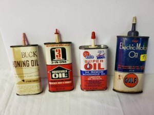 "(2) 4 FL. OZ OIL CANS AND (2) 3 FL. OZ OIL CANS GULF ELECTRIC-MOTOR OIL CAN, GULF EMBLEM, SIZE 4.5"" TALL, ALMOST EMPTY, PLASTIC SPOUT AND CAP, CAN SHOWS SCRATCHES, LIGHT PITTING IN SPOTS, DIRTY TOP, RUST ON LOWER CAN AND ON BOTTOM, DENT IN BACK -- SOLDER"