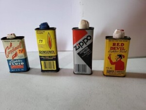 "(4) LIGHTER FLUID CANS - CARDINAL BRAND, 4 FL. OZ. SIZE 4"" TALL, EMPTY, COLOR SHOWS SOME WEAR, TOP SHOWS PITTING, BOTTOM RIM AND BOTTOM SHOW PITTING -- RED DEVIL, 4 FL. OZ., SIZE 4"" TALL, HALF FULL, GOOD COLOR, TOP SHOWS SOME DISCOLORATION, CLEAN BOTTOM -"