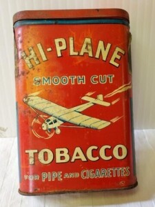 "VINTAGE TOBACCO TIN - HI-PLANE SMOOTH CUT TOBACCO FOR PIPE AND CIGARETTES, SIZE 4.75"" x 3"" x .75"", STAINS AND LIGHT PITTING ON WRITING, SCRATCHES AND WEAR, TOP AND BOTTO SHOWS PITTING AND RUST"
