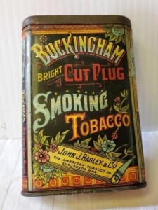 "VINTAGE TOBACCO TIN - BUCKINGHAM BRIGHT CUT PLUS SMOKING TOBACCO, SIZE 4.5"" TALL x 3"" x .75"", SHOWS WEAR, SCRAPES, SCRATCHES, TOP AND BOTTOM STAMP UNREADABLE, TOP TURNED WITH PITTING"