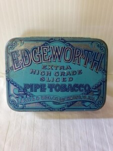 "VINTAGE TOBACCO TIN - EDGEWORTH EXTRA HIGH GRADE SLICED PIPE TOBACCO, LARUS & BRO. CO. RICHMOND, VA. U.S.A., SIZE 4.5"" x 3.5"" TALL x 1.25"",  GOOD COLOR, READABLE, SHOWS NUMEROUS SCRATCHES AND STAINS, NAME IS BRIGHT, INSIDE IS BRIGHT, BOTTOM IS BRIGHT, INS"