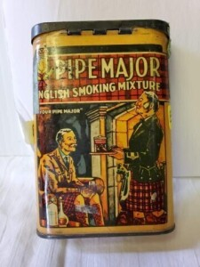 "VINTAGE TOBACCO TIN - PIPE MAJOR ENGLISH SMOKING MIXTURE, BROWN & WILLIAMSON TOBACCO CORP. LOUISVILLE, KY., U.S.A., SIZE 4.5"" TALL x 3"" WIDE x .75"", COLOR IS GOOD, PAINT SHOWS PECKS, SLIGHT DENT ON FRONT, NUMEROUS SCRATCHES, RUB AND LIGHT PITTED SPOTS ON"