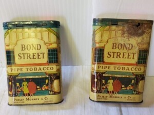 "(2) VINTAGE TOBACCO TINS - BOND STREET PIPE TOBACCO, PHILIP MORRIS & CO. NEW YORK LONDON, SIZE 4.5"" TALL x 3"" x 1"" - 1ST CAN COLOR ABOVE AVERAGE AND PICTURE SHARP FOR AGE, FEW SCRATCHES AND DISCOLORATION, TOP HAS STAMP RESIDUE WITH PITTING, BOTTOM SHOWS F"