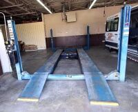 ROTARY AUTOMOTIVE LIFT  ~ 4 POST HYDRAULIC LIFT - BLUE - 12,000 LB. CAPACITY - BOLTS TO CONCRETE FLOOR - DRIVE ON RAMPS - DIMENSIONS: OUTSIDE EDGE OF POSTS 10 FT. 6 IN. X 17 FT. 6 IN. - HAS BEEN IN SERVICE UP UNTIL SHOP MOVED A FEW WEEKS AGO.  LIFT SELLS