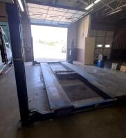 ROTARY AUTOMOTIVE LIFT  ~ 4 POST HYDRAULIC LIFT - BLUE - 12,000 LB. CAPACITY - BOLTS TO CONCRETE FLOOR - DRIVE ON RAMPS - DIMENSIONS: OUTSIDE EDGE OF POSTS 10 FT. 6 IN. X 17 FT. 6 IN. - HAS BEEN IN SERVICE UP UNTIL SHOP MOVED A FEW WEEKS AGO.  LIFT SELLS - 6
