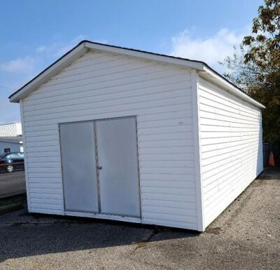 MODERN VINYL STORAGE BUILDING - 13 Ft. x 28 Ft. - (2) 3 FT. ENTRY DOORS (6 FT. X 6 FT. OPENING) - 8 FT. STUD SIDEWALLS & JOISTS - PLYWOOD FLOOR - NO INSULATION INTERIOR WALL OR CEILING.  BUILDING SITTING ON ASPHALT WITH EASY ACCESS.  BUYER RESPONSIBLE FOR