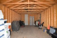 MODERN VINYL STORAGE BUILDING - 13 Ft. x 28 Ft. - (2) 3 FT. ENTRY DOORS (6 FT. X 6 FT. OPENING) - 8 FT. STUD SIDEWALLS & JOISTS - PLYWOOD FLOOR - NO INSULATION INTERIOR WALL OR CEILING.  BUILDING SITTING ON ASPHALT WITH EASY ACCESS.  BUYER RESPONSIBLE FOR - 3