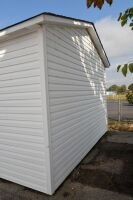 MODERN VINYL STORAGE BUILDING - 13 Ft. x 28 Ft. - (2) 3 FT. ENTRY DOORS (6 FT. X 6 FT. OPENING) - 8 FT. STUD SIDEWALLS & JOISTS - PLYWOOD FLOOR - NO INSULATION INTERIOR WALL OR CEILING.  BUILDING SITTING ON ASPHALT WITH EASY ACCESS.  BUYER RESPONSIBLE FOR - 9
