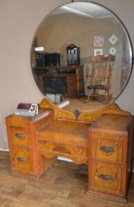DEPRESSION-ERA DRESSER WITH ROUND MIRROR