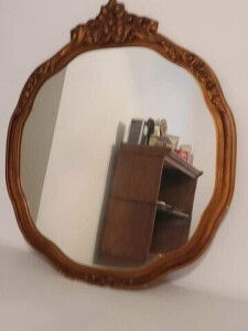 FRAMED WALL MIRROR WITH CARVED ORNATE TOP AND