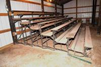 "FOLDING BLEACHERS -ROLLING PIPE BASE - WOOD SEATS & FLOORS - 2 SECTIONS - 7 ROWS OF SEATS - 2 SETS - 10' 7"" WIDE - DEPTH 12 FT. - TOP SEAT 6 FT. HIGH - 1ST SEAT 17"" TALL        (1L-7L SELLS AT LAND  AUCTION, FOLLOWING LAND AUCTION)"