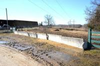 "(7) CONCRETE ""J"" STYLE FEED TROUGH -TAKE ALL (7 X MONEY) - SOUTH SIDE LANE ON TRACT 8"
