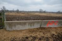 "(6 CONCRETE ""J"" STYLE FEED TROUGH - BULL PEN  EAST OF FEED MIXING SHED - ON TRACT 8 - 6 TIMES THE MONEY"