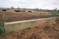 "(7) CONCRETE ""J"" STYLE FEED TROUGHS-  7 X MONEY COWPEN SOUTHEAST OF BULL PEN - INSIDE CORNER IS BROKEN OFF"