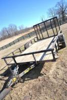 BIG TEX BUMPER TRAILER 355A 7 FT. X 12 FT. BED -LOADING GATE - OUTSIDE RAILS  SLIGHTLY BENT ON LOADING GATE - WOOD FLOOR IN  AVERAGE CONDITION - NEW JACK