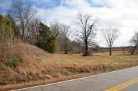 TRACT 11:  89+/- ACRES LOCATED AT 10360 HWY. 220 AT SOUTH END OF FOUR L FARMS.  IN ATWOOD TURN ON HWY. 220 S,  GO 3.6 MILES TO FARM ON LEFT.  1 CRE HOUSE LOT ADDED TO FARM.  LARGE STOCK BARN.  49.79 CROPLAND ACRES.  PLENTY OF WOODS FOR GOOD HINTING & HOBBY FARM.   ROLLING HILL LAND EAST OF TRACT 12, SOUTH OF TRACT 8 & 9